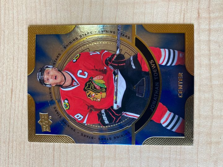 2013/14 Upper Deck Series One Shining Stars Gold card, Jonathan Toews, number C2